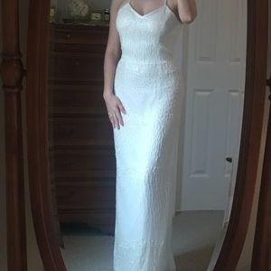 Off-white beaded floor length dress.